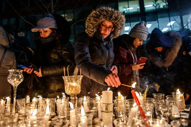 Members of Montreal's Iranian community attend a vigil, Thursday, Jan. 9, 2019 in downtown Montreal. (Andrej Ivanov/The Canadian Press via AP)