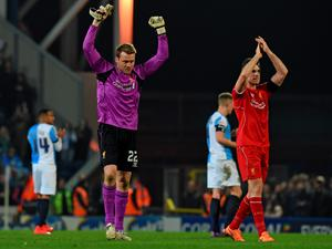 Liverpool's Belgian goalkeeper Simon Mignolet (2nd L) celebrates on the pitch with Liverpool's English midfielder Jordan Henderson (R) after the English FA Cup quarter-final replay football match between Blackburn Rovers and Liverpool at Ewood Park in Blackburn, north west England on April 8, 2015. Liverpool won the game 1-0. AFP PHOTO / PAUL ELLIS  RESTRICTED TO EDITORIAL USE. NO USE WITH UNAUTHORIZED AUDIO, VIDEO, DATA, FIXTURE LISTS, CLUB/LEAGUE LOGOS OR LIVE SERVICES. ONLINE IN-MATCH USE LIMITED TO 45 IMAGES, NO VIDEO EMULATION. NO USE IN BETTING, GAMES OR SINGLE CLUB/LEAGUE/PLAYER PUBLICATIONS.PAUL ELLIS/AFP/Getty Images