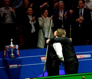 Stuart Bingham (right) is congratulated by Shaun Murphy after winning the Betfred World Championships at the Crucible Theatre, Sheffield. PRESS ASSOCIATION Photo. Picture date: Monday May 4, 2015. See PA story SNOOKER World. Photo credit should read: Anna Gowthorpe/PA Wire