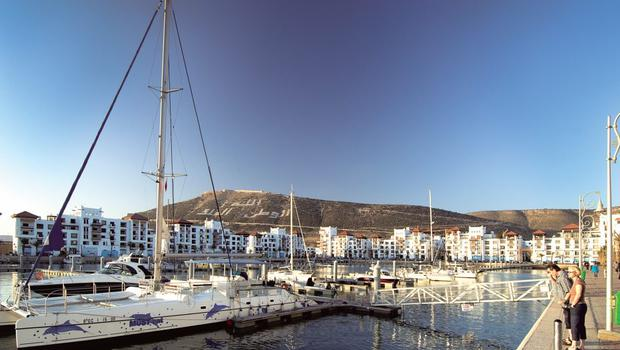 Mountains and the sea: The busy promenade stretches for 10 kilometres and goes right down to the marina where there are restaurants and European stores