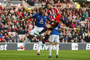 Sunderland's Steven Fletcher (R) is challenged by Everton's Sylvain Distin. Photo credit: REUTERS/Andrew Yates