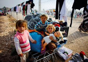 Kurdish refugee girls from the Syrian town of Kobani play in a refugee camp in the Turkish border town of Suruc, Sanliurfa province