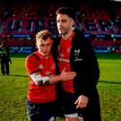 Two-halves: Munster's Conor Murray and Craig Casey embrace after the game at Thomond Park. Photo: Brendan Moran/Sportsfile
