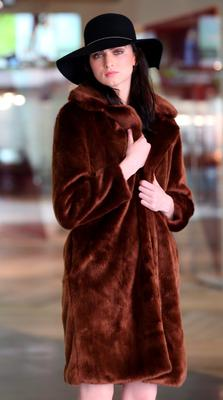 Maria Boardman wers a Brown faux fur coat €45 and hat, €10