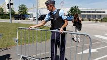 A French Gendarme blocks the access road to the Saint-Quentin-Fallavier industrial area, near Lyon, France