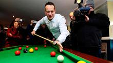 On cue: Taoiseach Leo Varadkar plays pool in The Midland Bar while on the campaign trail in Enfield, Co Meath. Photo: Brian Lawless/PA
