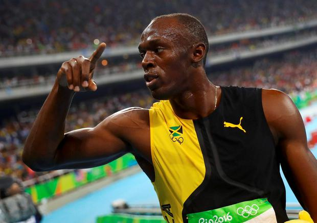 Usain Bolt (JAM) of Jamaica celebrates winning the gold medal