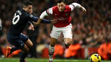 Arsenal's Mesut Ozil and Manchester United's Robin van Persie (left) battle for the ball