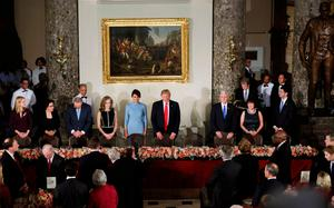U.S. President Donald Trump and first lady Melania stand with Vice President Mike Pence and his wife Karen Pence during the Inaugural luncheon at the National Statuary Hall in Washington, U.S, January 20, 2017.  REUTERS/Yuri Gripas