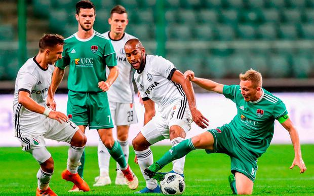 Conor McCormack steals the ball off Legia's Jose Kante with a sliding tackle. Photo: Lukasz Grochala/Sportsfile