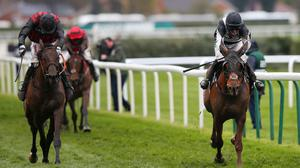 Jockey Tabitha Worsley riding Top Wood (R) races towards victory ahead of jockey Derek O'Connor riding Burning Ambition (L) in Randox Health Foxhunters' Open Hunters' Chase during Grand National Thursday at Aintree Racecourse on April 04, 2019 in Liverpool, England. (Photo by Alex Livesey/Getty Images)