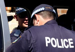 Police stand outside a house that was involved in pre-dawn raids in the western Sydney suburb of Guilford September 18, 2014.  REUTERS/David Gray