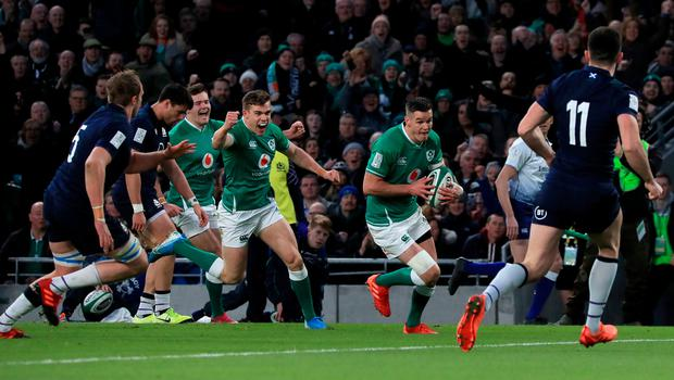 Ireland's Johnny Sexton scores his side's first try during the Guinness Six Nations win over Scotland at the Aviva Stadium, Dublin.