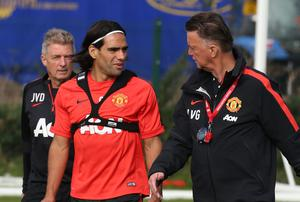 Manchester United manager Louis Van Gaal speaks with new signing Radamel Falcao during training at Carrington