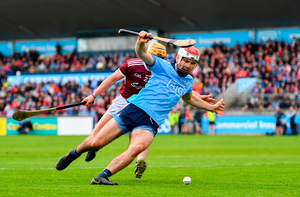 Paddy Smyth of Dublin in action against David Glennon of Galway. Photo by Ramsey Cardy/Sportsfile