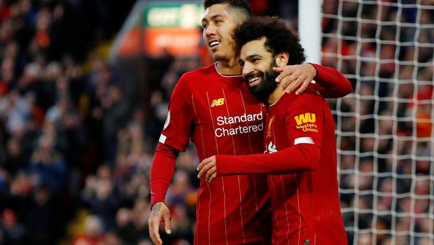 Liverpool's Mohamed Salah celebrates scoring their third goal with Roberto Firmino  against Southampton at Anfield