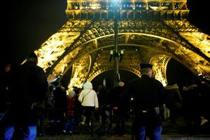 French police patrol in front of the Eiffel Tower in Paris on New Year's Eve, December 31, 2015.  AFP PHOTO / MATTHIEU ALEXANDREMATTHIEU ALEXANDRE/AFP/Getty Images