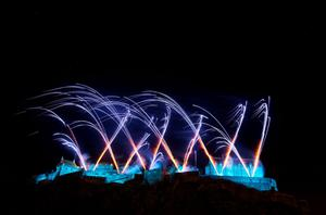 EDINBURGH, SCOTLAND - DECEMBER 31:  Fireworks light up the sky above Edinburgh castle as part of Hogmanay celebrations.  Unicef wishes Edinburgh a #HappyBlueYear by adding a hint of blue to the iconic Hogmanay firework display on December 31, 2015 in Edinburgh, Scotland.  (Photo by Ross Gilmore/Getty Images for Unicef)