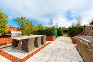 The rear patio with dual barbeque areas