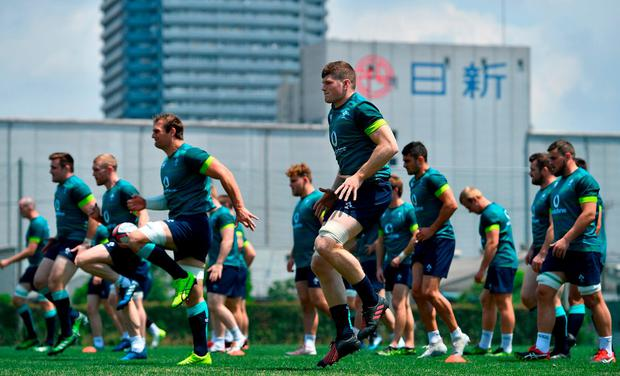 The Ireland team warm-up during a squad training session in Tokyo, Japan. Photo: Brendan Moran/Sportsfile