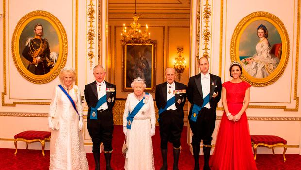 (Left to right) The Duchess of Cornwall, the Prince of Wales, Queen Elizabeth II, the Duke of Edinburgh, and Duke and Duchess of Cambridge arrive for the annual evening reception for members of the Diplomatic Corps at Buckingham Palace, London.