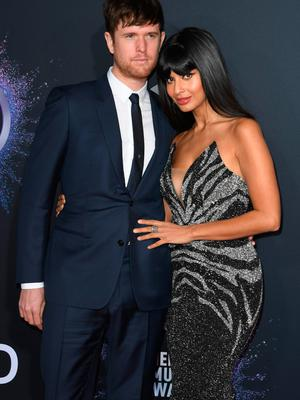 British actress Jameela Jamil and partner musician James Blake arrive for the 2019 American Music Awards at the Microsoft theatre on November 24, 2019 in Los Angeles. (Photo by Mark RALSTON / AFP)