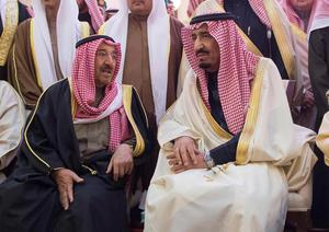 Saudi King Salman sits next to Kuwait's Emir Sheikh Sabah al-Ahmed al-Sabah during the funeral of the late Saudi King Abdullah in Riyadh, as new Saudi King Salman pledged continuity in energy and foreign policies on Friday and then quickly moved to appoint younger men as his heirs (REUTERS)
