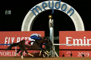Thunder Snow (No 12) and jockey Christophe Soumillon get the better of Gronkowski on the nod to land the Dubai World Cup. Photo: REUTERS/Christopher Pike