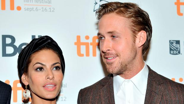 """Actors (L-R) Eva Mendes and Ryan Gosling attend """"The Place Beyond The Pines"""" premiere during the 2012 Toronto International Film Festival at Princess of Wales Theatre on September 7, 2012 in Toronto, Canada.  (Photo by Sonia Recchia/Getty Images)"""