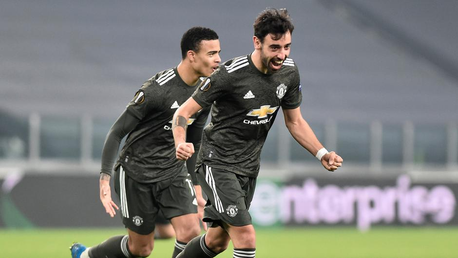 Manchester United's Bruno Fernandes celebrates scoring their second goal with Mason Greenwood Soccer Football - Europa League - Round of 32 First Leg - Real Sociedad v Manchester United - Allianz Stadium, Turin, Italy - February 18, 2021  REUTERS/Massimo Pinca