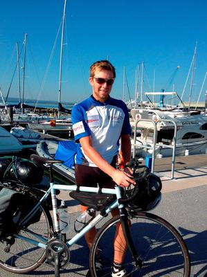 Undated handout photo dated 08/08/15 of Tom Davies in Poole, as the teenager may become the youngest ever person to cycle around the world when he completes the final leg of his epic 18,000-mile journey. PRESS ASSOCIATION Photo. Issue date: Sunday August 9, 2015. See PA story CHARITY Cyclist. Photo credit should read: PA Wire  NOTE TO EDITORS: This handout photo may only be used in for editorial reporting purposes for the contemporaneous illustration of events, things or the people in the image or facts mentioned in the caption. Reuse of the picture may require further permission from the copyright holder.