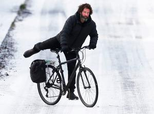 A man cycles in Lucan, Co Dublin, yesterday, after snow fell over much of the country on Wednesday night