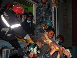Rishi Khanal being freed from the damage hotel by rescue teams