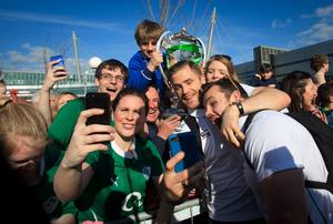 22/03/2015 Jamie Heaslip & Cian Healy with Irish fans after the Irish Rugby side  arrived  at Dublin Airport following their 6 Nations Championship win  Photo:  Gareth Chaney Collins