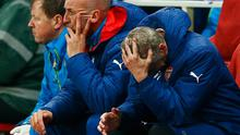 Arsene Wenger, manager of Arsenal reacts on the bench as a 3-0 lead is lost during the UEFA Champions League Group D match between Arsenal FC and RSC Anderlecht at Emirates Stadium