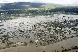 An aerial view shows residential areas flooded by the Chikuma river, caused by Typhoon Hagibis in Nagano, central Japan, October 13, 2019, in this photo taken by Kyodo Mandatory credit Kyodo/via REUTERS