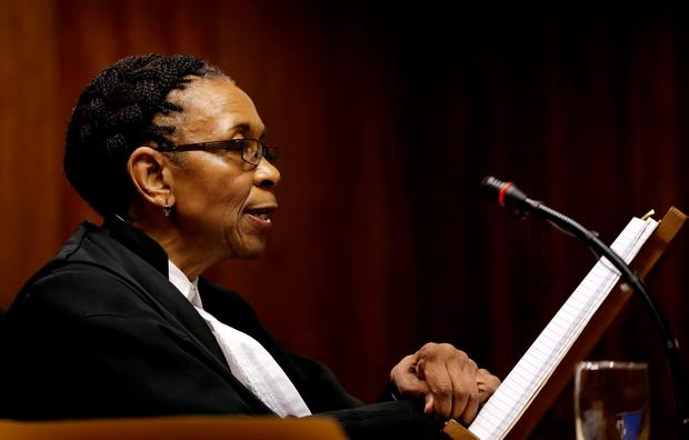 Judge Thokozile Masipa reads her verdict during an appeal hearing brought by prosecutors against the six-year jail term handed to Oscar Pistorius