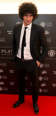 Manchester United's Belgian midfielder Marouane Fellaini  poses for pictures on the red carpet as he arrives to attend the 'Manchester United Player of the Year Awards' at Old Trafford stadium in Manchester, northern England, on May 19, 2015. AFP PHOTO / OLI SCARFFOLI SCARFF/AFP/Getty Images