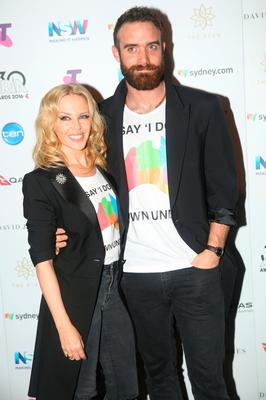 Kylie Minogue and Joshua Sasse pose in the ARIA awards room during the 30th Annual ARIA Awards 2016 at The Star on November 23, 2016 in Sydney, Australia.  (Photo by Cole Bennetts/Getty Images)