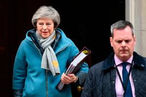 Uphill battle: UK Prime Minister Theresa May leaves 10 Downing Street for the House of Commons to face Prime Minister's Questions yesterday. Photo: PA