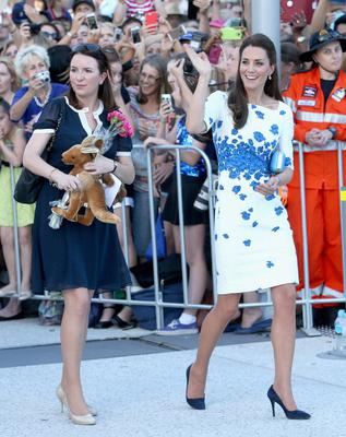 Private Secretary Rebecca Deacon carries a stuffed Kangaroo as Catherine, Duchess of Cambridgas she does a walkabout on the South Bank on April 19, 2014 in Brisbane, Australia.  (Photo by Chris Jackson/Getty Images)