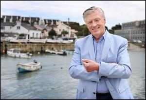 HOME THOUGHTS: Pat Kenny at Bulloch Harbour in Dalkey. 'This is not the worst place in the world to cocoon,' he says.  Photo: Steve Humphreys