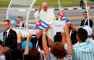 Pope Francis waves upon arriving to give the first mass of his visit to Cuba in Havana's Revolution Square, September 20, 2015. Reuters/Carlos Garcia Rawlins