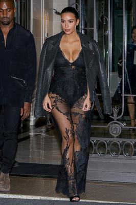 Kim Kardashian and Kanye West leave the 'Art District' apartments on September 28, 2014 in Paris, France.  (Photo by Marc Piasecki/GC Images)