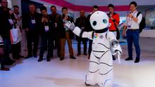 A robot dances on a Chinese mobile company's stand at Mobile World Congress