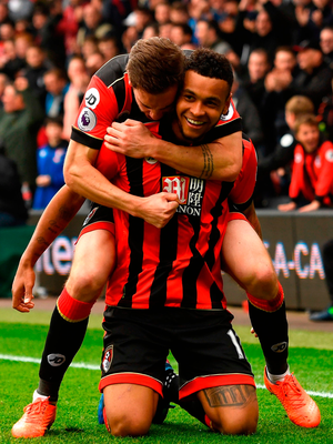 BOURNEMOUTH, ENGLAND - MARCH 11:  Joshua King of AFC Bournemouth celebrates scoring his sides second goal with Dan Gosling during the Premier League match between AFC Bournemouth and West Ham United  at Vitality Stadium on March 11, 2017 in Bournemouth, England.  (Photo by Stu Forster/Getty Images)