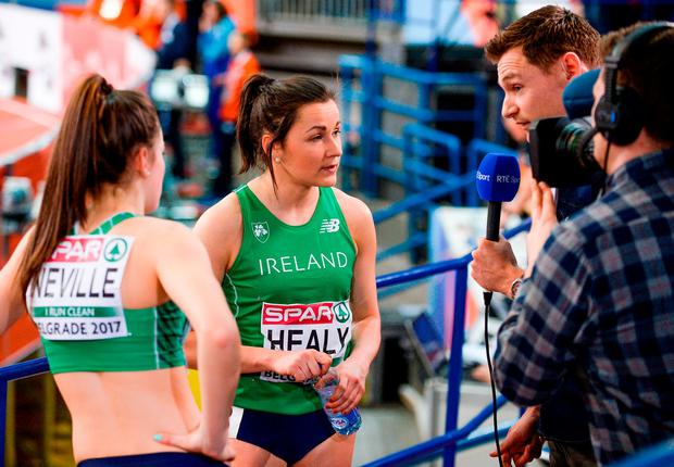 Phil Healy and Ciara Neville speak with David Gillick after their 60m semi-finals in Belgrade. Photo: Sam Barnes/Sportsfile