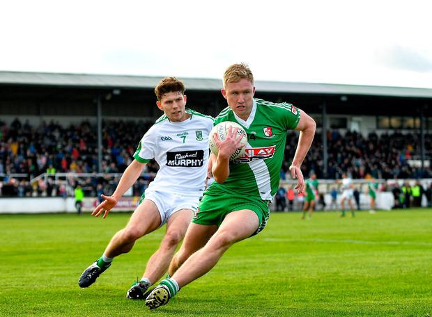 Sarsfield's Ray Cahill under pressure from Seán Healy of Moorefield. Photo: Seb Daly/Sportsfile