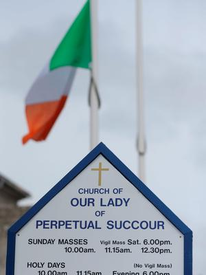 A flag flies at half mast at Our Lady of Perpetual Succour church in Foxrock, Dublin, to honour the victims of the Berkeley balcony collapse. Niall Carson/PA Wire