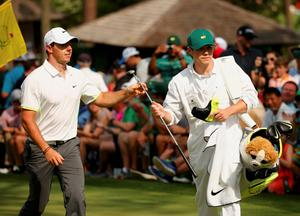 One Direction singer Niall Horan (R) caddies for Rory McIlroy of Northern Ireland during the par 3 event held ahead of the 2015 Masters at Augusta National Golf Course in Augusta, Georgia April 8, 2015